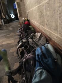 Backpacks lining the cathedral walls